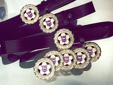 Photograph of belts with custom buckles for football club supporters