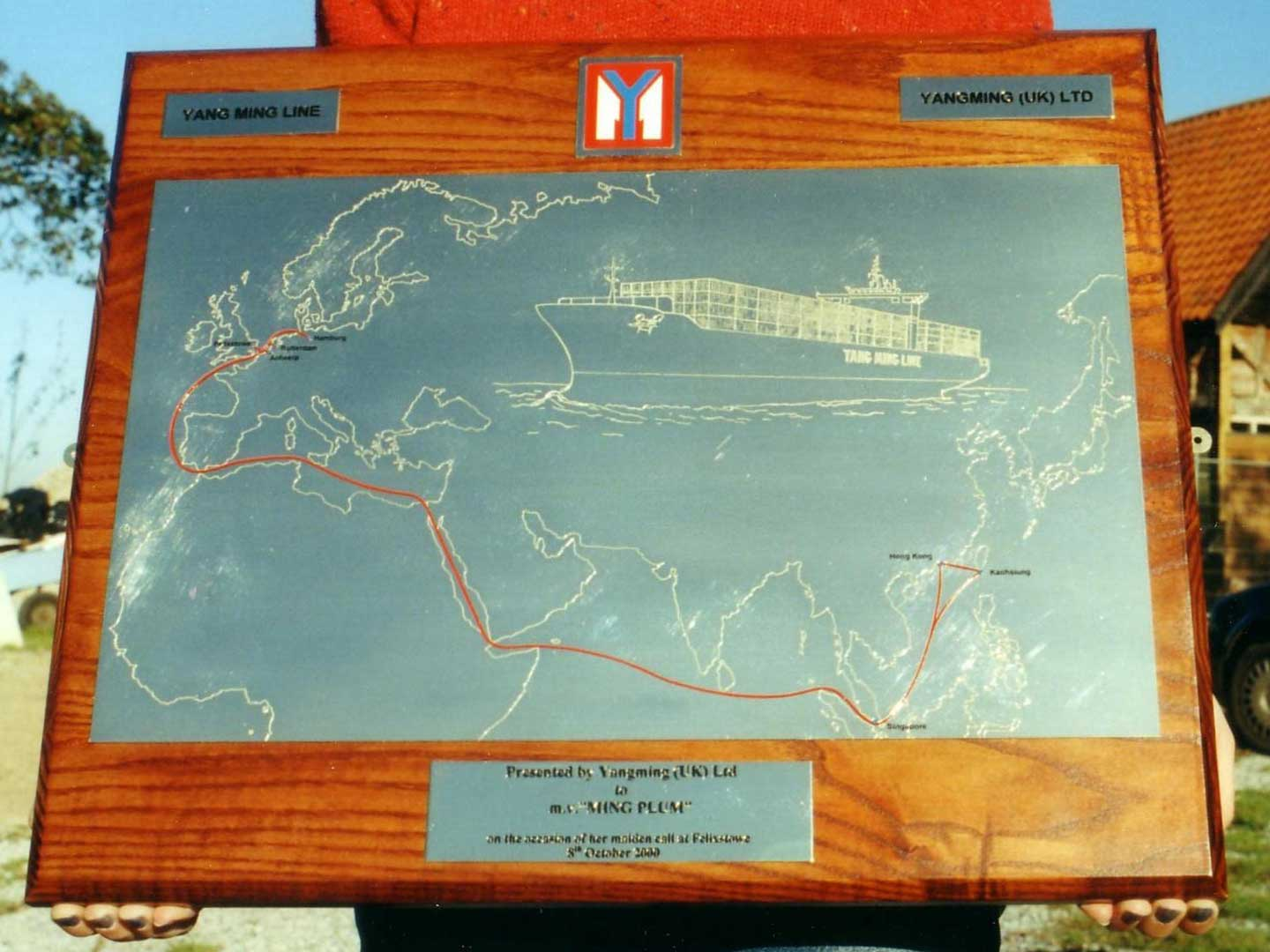 Mounted engraved plaque showing shipping route for Yang Ming Shipping